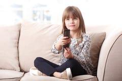 Adorable little girl watching tv Stock Photos