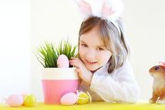 Adorable little girl wearing bunny ears on Easter Stock Photo