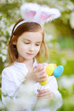 Adorable little girl wearing bunny ears on Easter Stock Photos