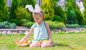 Adorable little girl wearing bunny ears holding Royalty Free Stock Photos