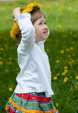 Adorable little girl wearing flower chaplet Stock Photo