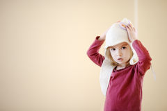 Adorable little girl wearing funny hat Royalty Free Stock Photography