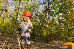 Adorable little girl wearing an orange hardhat Royalty Free Stock Photos