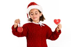 Adorable little girl wearing santa hat with Christmas biscuits Stock Images