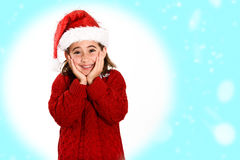 Adorable little girl wearing santa hat isolated on fantasy backg. Round. Winter clothes for Christmas Stock Photos