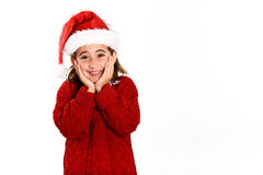 Adorable little girl wearing santa hat isolated on white backgro. Und. Winter clothes for Christmas Royalty Free Stock Photos