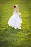 Adorable Little Girl Wearing White Dress In A Grass Field Royalty Free Stock Images
