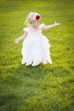 Adorable Little Girl Wearing White Dress In A Grass Field Stock Images