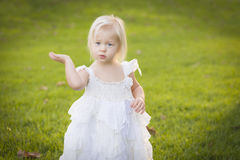 Adorable Little Girl Wearing White Dress In A Grass Field Royalty Free Stock Image