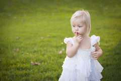 Adorable Little Girl Wearing White Dress In A Grass Field Stock Photos