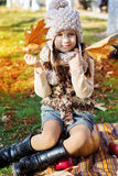 Adorable little girl is wearing winter clothes Royalty Free Stock Photo