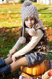 Adorable little girl is wearing winter clothes Stock Photo