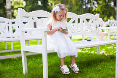 Adorable little girl at a wedding ceremony Stock Image
