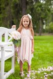 Adorable little girl at a wedding ceremony Stock Images