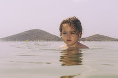 Adorable little girl with wet hair in sea Royalty Free Stock Images