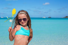 Adorable little girl at white beach during summer royalty free stock photography