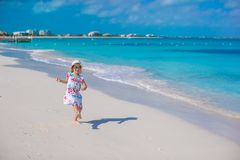 Adorable little girl at white beach during summer Stock Image