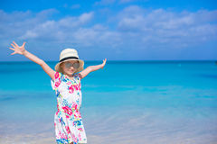 Adorable little girl at white beach during summer Stock Images