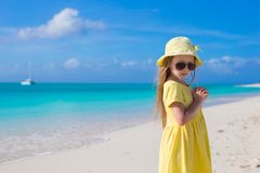 Adorable little girl at white beach during summer Stock Photos