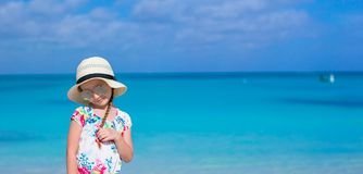 Adorable little girl at white beach during summer Stock Photo
