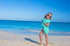 Adorable little girl at white beach during summer Royalty Free Stock Images