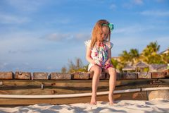 Adorable little girl at white tropical beach in Stock Images