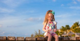 Adorable little girl at white tropical beach in Royalty Free Stock Photography
