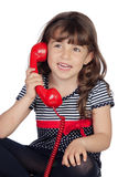 Adorable little girl wiht red phone Royalty Free Stock Image
