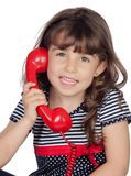 Adorable little girl wiht red phone Stock Photography
