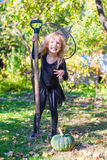 Adorable little girl in witch costume on Halloween Stock Photo