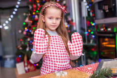 Adorable little girl in wore mittens baking Royalty Free Stock Photos