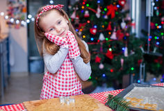 Adorable little girl in wore mittens baking Royalty Free Stock Photography