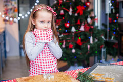 Adorable little girl in wore mittens baking Stock Photo