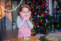 Adorable little girl in wore mittens baking Stock Images