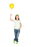 Adorable little girl with yellow balloon Royalty Free Stock Photos