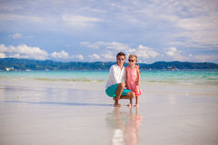 Adorable little girl and young dad on white sandy Royalty Free Stock Photography