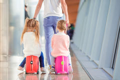 Adorable little girls in airport sitting on Royalty Free Stock Image
