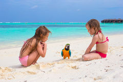 Adorable little girls at beach with colorful Royalty Free Stock Photos