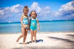 Adorable little girls at beach during summer Stock Photo