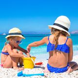 Adorable little girls at beach during summer Royalty Free Stock Image
