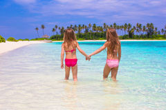Adorable little girls at beach during summer Stock Photos