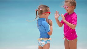 Adorable little girls at beach during summer vacation. Adorable little girls at beach during vacation stock video