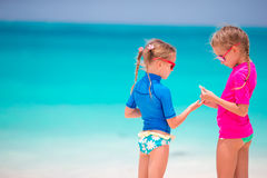 Adorable little girls at beach during summer vacation Stock Images