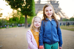 Adorable little girls enjoying themselves by the Eiffel tower in Paris Royalty Free Stock Image