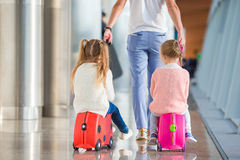 Adorable little girls with father in airport Royalty Free Stock Image