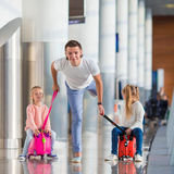 Adorable little girls with father in airport have Stock Photo