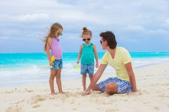 Adorable little girls and happy dad on tropical Stock Images