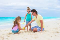 Adorable little girls and happy dad on tropical Royalty Free Stock Photography