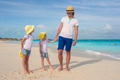 Adorable little girls and happy father on tropical white beach Royalty Free Stock Photography