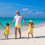 Adorable little girls and happy father on tropical white beach Royalty Free Stock Image